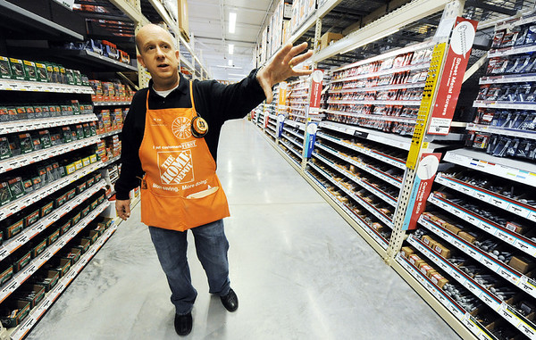 Globe/T. Rob Brown<br /> The Home Depot Store Manager Steve Cope talks about the store's grand re-opening as well as the fact that even though this store's total square feet is less, they found ways to offer many new products for the customers during a tour Tuesday afternoon, Jan. 10, 2012. The Home Depot on Range Line Road re-opens Thursday.