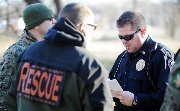 Globe/T. Rob Brown<br /> Sgt. David Newell (right), Joplin Police Department, speaks with search & rescue members as they plan the search for a missing Joplin man Monday afternoon, Jan. 2, 2012, within a couple blocks of the intersection of Newman Road and Florida Avenue.