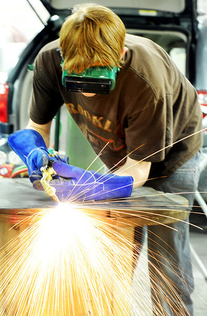 Globe/T. Rob Brown<br /> Drew Holle, a Joplin High School junior, practices his cutting torch technique Tuesday afternoon, Jan. 31, 2012, in his auto collision repair class at Franklin Tech.