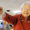 Globe/T. Rob Brown<br /> Billie Camp, 95, of Joplin, waves toward her ball, wishing it to veer into the pins Tuesday afternoon, Jan. 17, 2012, at Fourth Street Bowl in Joplin.