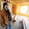 Globe/T. Rob Brown<br /> Larry Jump examines the interior of his family's future home that is running behind and over budget during a tour of the unfinished home Tuesday afternoon, Jan. 3, 2012. The Jumps lost their home to the May 22, 2011, tornado.