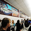 Globe/T. Rob Brown<br /> Joplin High School students walk Tuesday morning, Jan. 10, 2012, under a series of new wall murals by Carthage artist Sherry Pettey depicting Joplin High School before and after the May 22, 2011, tornado. The murals, currently hanging in the Memorial School 9th- and 10th-grade campus, were first shown to the public during a 10 a.m. ceremony attended by the artist. After completion of a new Joplin High School, the murals will be moved there.