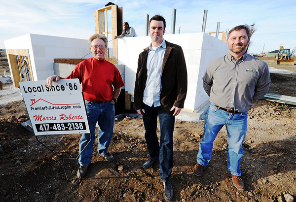 Globe/T. Rob Brown<br /> Morris Roberts (left), owner of Premier Builders, the general contractor, home owner Greg Palmersheim and Eric Jeffries, president of Jeffries Plumbing Heating & Air Conditioning, stand in front of a concrete home under construction Tuesday afternoon, Jan. 24, 2012, near the intersection of 19th Street and Highland Avenue. The space between the layers of styrofoam walls will be filled with concrete.