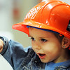 "Globe/T. Rob Brown<br /> Three-year-old Zekiel Edgar, of Joplin, points at a little house used to show shingles and other roof components during the grand re-opening event for The Home Depot on Range Line Road in Joplin. Children and some adults were given hardhats with a sticker that reads, ""In Our Hearts, Store #3023."""
