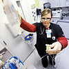 Globe/T. Rob Brown<br /> Registered Nurse Jessica Lee primes I.V. tubing for a patient at Freeman East Thursday afternoon, Jan. 12, 2012, in the current TCU (Transitional Care Unit) for Freeman Health System. The TCU will move to a new expansion, located on the fifth and sixth floors, which is expected to add more than 100 nurses to the hospital's staff plus additional support personnel.