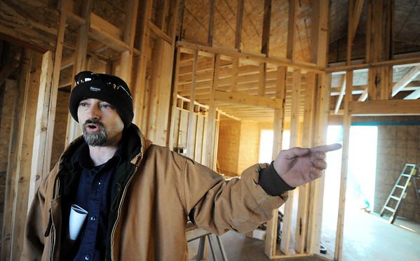 Globe/T. Rob Brown<br /> Larry Jump talks about various issues with the interior of his family's future home that is running behind and over budget during a tour of the unfinished home Tuesday afternoon, Jan. 3, 2012. The Jumps lost their home to the May 22, 2011, tornado.