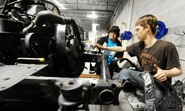 Globe/T. Rob Brown<br /> Drew Holle, right, a Joplin High School junior, and senior Zack Hibbard work on repairs to the front end of a vehicle Tuesday afternoon, Jan. 31, 2012, in their auto collision repair class at Franklin Tech.