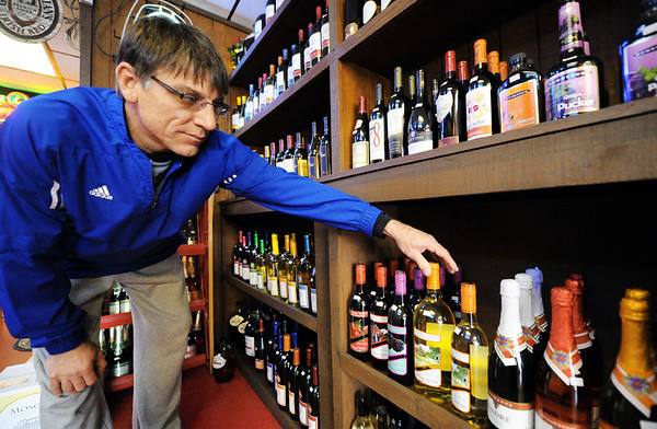 Globe/T. Rob Brown<br /> Owner Rob Cicero arranges the wine choices at Cicero Liquor in Pittsburg, Kan., Wednesday afternoon, Jan. 18, 2012.