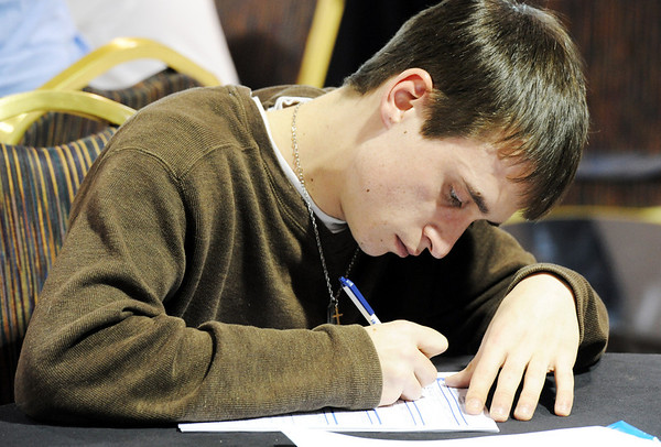 "Globe/T. Rob Brown<br /> Zachary Davis, of Joplin, fills out an employment application Thursday afternoon, Jan. 19, 2012, during the Job Fair at the Holiday Inn Convention Center in Joplin. ""I've been looking for a while,"" Davis said. ""I'm hoping this will help."""