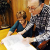 Globe/T. Rob Brown<br /> Roger and Sherrie Stinnett look over letters and bills Thursday afternoon, Jan. 26, 2012, they've received since May 22, 2011, for a security service they no longer receive a benefit from at their former Joplin address. The couple have since moved to Carthage.