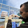 Globe/T. Rob Brown<br /> Clint Owens, a territory manager with vendor Tree Town USA from Oklahoma City, builds a tree rack watering system Tuesday afternoon, Jan. 10, 2012, as vendors and employees of The Home Depot work to get the Joplin store ready for its Thursday Grand Re-opening.