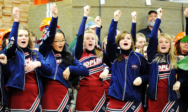 Globe/T. Rob Brown<br /> Joplin High School cheerleaders give a chant for The Home Depot during the grand re-opening event Wednesday evening, Jan. 11, 2012, for The Home Depot on Range Line Road in Joplin.