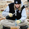 Globe/T. Rob Brown<br /> Sarah Riner, Americorps NCCC program team member from Dalton, Ga., preserves bricks from the Signature House Friday morning, Jan. 20, 2012, in the Joplin tornado zone near the intersection of 25th Street and Joplin Avenue.