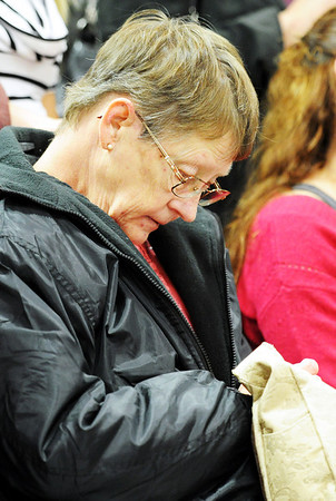 Globe/T. Rob Brown<br /> Wife of The Home Depot employee who lost his life during the May 22, 2011, tornado bows her head as he and the customers who died are remembered during the grand re-opening event Wednesday evening, Jan. 11, 2012, for The Home Depot on Range Line Road in Joplin.