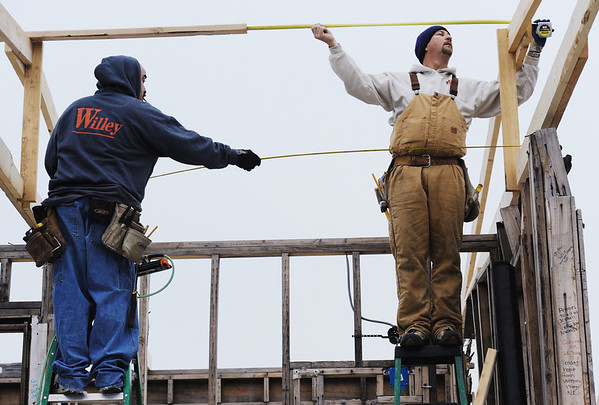 Globe/T. Rob Brown<br /> Steve Willey (right), co-owner of Willey Construction of Joplin, and carpenter Antonio Amaya take measurements as they install trusses at the Signature House Friday morning, Jan. 20, 2012, in the Joplin tornado zone near the intersection of 25th Street and Joplin Avenue.