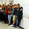 Globe/T. Rob Brown<br /> Carthage artist Sherry Pettey (right) speaks to Joplin High School students Tuesday morning, Jan. 10, 2012, during an unveiling ceremony for a series of new wall murals she painted depicting Joplin High School before and after the May 22, 2011, tornado. The murals, currently hanging in the Memorial School 9th- and 10th-grade campus, were first shown to the public during a 10 a.m. ceremony. After completion of a new Joplin High School, the murals will be moved there.