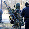 Globe/T. Rob Brown<br /> Search & rescue members, which includes Joplin SWAT, begin the search for a missing Joplin man Monday afternoon, Jan. 2, 2012, within a couple blocks of the intersection of Newman Road and Florida Avenue.
