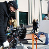 "Globe/T. Rob Brown<br /> Director Julian Chojnacki sets up a Red Epic digital cinema camera for a white balance with help from Tim Bezy, still photographer and director of photography, as they prepare for a downtown Joplin shoot Friday afternoon, Jan. 13, 2012, for Kaleb McIntire's country music video ""Redneck in All of Us."" McIntire said they will be doing another part of the shoot at his family's Joplin farm."