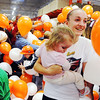 Globe/T. Rob Brown<br /> Hanah Schrader, 13, holds her sister Kya Thorn, 1, after catching a balloon filled with a prize coupon during the grand re-opening event Wednesday evening, Jan. 11, 2012, for The Home Depot on Range Line Road in Joplin.