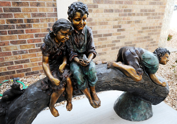 Globe/T. Rob Brown<br /> A sculpture of children outside Will's Place, a healing center for kids and part of Ozark Center, on West 30th Street in Joplin Tuesday afternoon, Jan. 10, 2012.