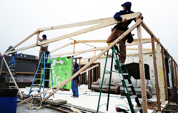 Globe/T. Rob Brown<br /> Steve Willey (center), co-owner of Willey Construction of Joplin, leads his crew as they install a truss at the Signature House Friday morning, Jan. 20, 2012, in the Joplin tornado zone near the intersection of 25th Street and Joplin Avenue. Carpenters, pictured from left, are Bryan Baldwin, Willey, Antonio Amaya (below) and Tyler Benford.