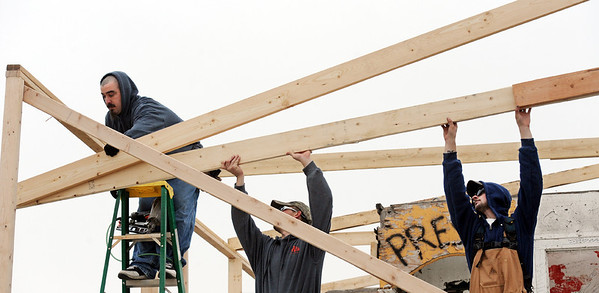 Globe/T. Rob Brown<br /> Carpenters (from left) Antonio Amaya, Bryan Baldwin and Tyler Benford, all with Willey Construction of Joplin, install a truss at the Signature House Friday morning, Jan. 20, 2012, in the Joplin tornado zone near the intersection of 25th Street and Joplin Avenue.
