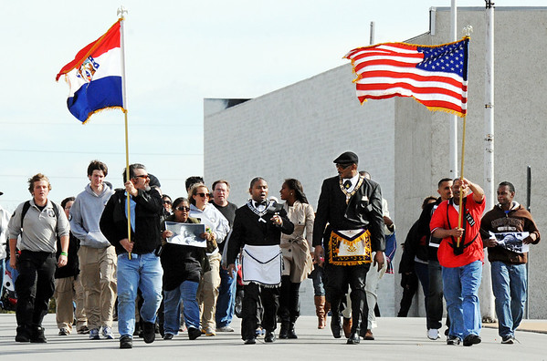 Globe/T. Rob Brown<br /> Locals and members of the Myrtle Lodge No. 149 participate in a parade honoring the legacy of Martin Luther King Jr. Monday afternoon, Jan. 16, 2012, on Third Street in downtown Joplin. The parade, in honor of the civil rights leader, started at the intersection of Langston Hughes-Broadway and St. Louis Avenue and continued on to the Joplin Public Library.
