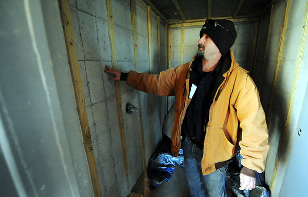 Globe/T. Rob Brown<br /> Larry Jump examines the storm shelter closet in his family's future home that is running behind and over budget during a tour of the unfinished home Tuesday afternoon, Jan. 3, 2012. The Jumps lost their home to the May 22, 2011, tornado.