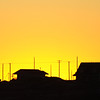 The silhouettes of houses once again grace the horizon at sunset Monday, Jan. 2, 2012, in the Joplin, Mo., tornado zone. With 2011 coming to an end, Joplin continues to rebuild into 2012. (AP Photo/The Joplin Globe, T. Rob Brown)