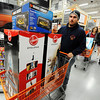 Globe/T. Rob Brown<br /> Justin Pendergraft, of Seneca, gets in line to purchase a cart full of small appliances during the grand re-opening event Wednesday evening, Jan. 11, 2012, for The Home Depot on Range Line Road in Joplin.