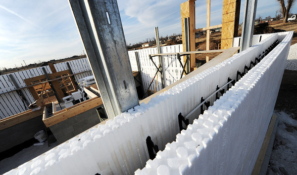 Globe/T. Rob Brown<br /> An over-the-wall view of a concrete home under construction Tuesday afternoon, Jan. 24, 2012, near the intersection of 19th Street and Highland Avenue. The space between the layers of styrofoam will be filled with concrete.