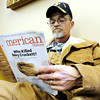 "Globe/T. Rob Brown<br /> Pat Skelton, of Joplin, keeps out of the cold by reading a copy of ""American History"" at the Joplin Public Library Thursday afternoon, Jan. 12, 2012. Skelton said he was enjoying an article about the first four inductees to the Major League Baseball Hall of Fame because it was too cold to be outside. Joplin received snowfall both late Wednesday night and off-and-on Thursday."