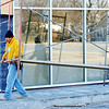 Globe/T. Rob Brown<br /> Masons Alejandro Gomez (left) and Martin Rodriguez with Plowman Construction Co. of Olathe, Kan., maneuver scaffolding while doing exterior work Monday afternoon, Jan. 9, 2012, at the Payless Shoesource on Range Line Road in Joplin.