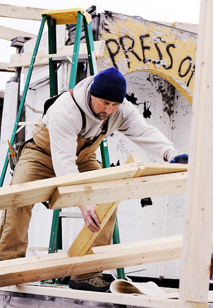 Globe/T. Rob Brown<br /> Steve Willey, co-owner of Willey Construction of Joplin, presses on as he works with his crew to install trusses at the Signature House Friday morning, Jan. 20, 2012, in the Joplin tornado zone near the intersection of 25th Street and Joplin Avenue.