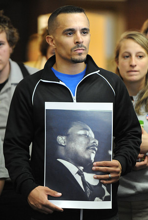 Globe/T. Rob Brown<br /> Dantley Harbin, of Joplin, holds a photograph of Martin Luther King Jr. as the crowd listens to members of the Myrtle Lodge No. 149 during a speech following a parade to honor the King's legacy Monday afternoon, Jan. 16, 2012, at the Joplin Public Library. The parade, in honor of the civil rights leader, started at the intersection of Langston Hughes-Broadway and St. Louis Avenue and continued on to the Joplin Public Library.