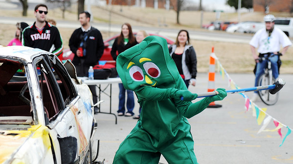"Gumby goes ballistic<br /> Globe/T. Rob Brown<br /> Keaton Burke, a Missouri Southern State University sophomore criminal justice major, wears a Gumby costume as he strikes a car for charity Friday afternoon, Jan. 27, 2012, in MSSU's parking lot. Kappa Alpha Order, Delta Pi Chapter, sold hits on the car with proceeds going to the Muscular Distrophy Association. ""I used to use the costume when I worked at a pizza place,"" Burke said. ""Now I wear it because it makes people laugh."""