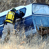 Globe/T. Rob Brown<br /> A search & rescue team member checks an abandoned pickup camper for a missing Joplin man Monday afternoon, Jan. 2, 2012, within a couple blocks of the intersection of Newman Road and Florida Avenue.