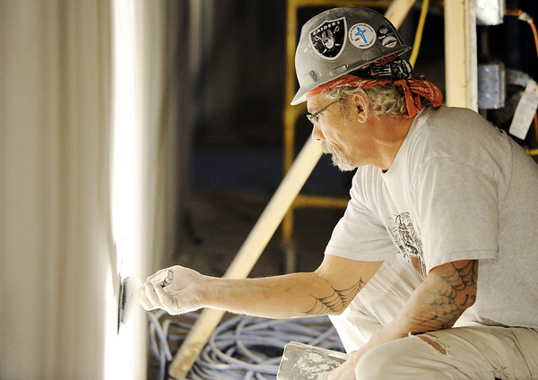 Globe/T. Rob Brown<br /> Randy Ruble, a sheetrock finisher, works on the fifth floor of Freeman East Thursday afternoon, Jan. 12, 2012, which will be the future location of the Cardiac Medical Unit for Freeman Health System. This expansion is expected to add more than 100 nurses to the hospital's staff plus additional support personnel.