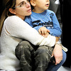 Globe/T. Rob Brown<br /> Jamie Cope, wife of Store Manager Steve Cope, holds their son Joseph Cope, 4, as they watch the grand re-opening event Wednesday evening, Jan. 11, 2012, for The Home Depot on Range Line Road in Joplin.