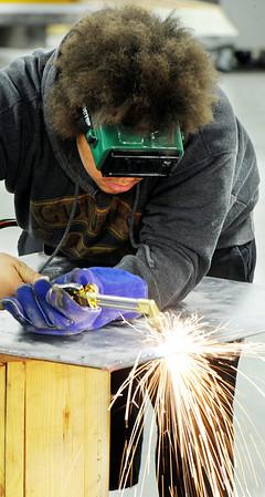 Globe/T. Rob Brown<br /> Jacob Stewart, a Joplin High School junior, practices his cutting torch technique Tuesday afternoon, Jan. 31, 2012, in his auto collision repair class at Franklin Tech.