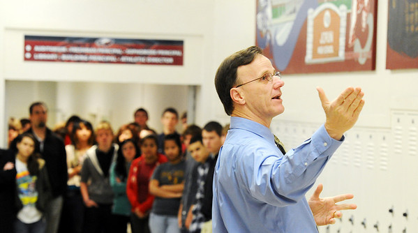Globe/T. Rob Brown<br /> Dr. Kerry Sachetta, Joplin High School principal, speaks to students Tuesday morning, Jan. 10, 2012, during the unveiling ceremony for a series of new wall murals by Carthage artist Sherry Pettey depicting Joplin High School before and after the May 22, 2011, tornado. The murals, currently hanging in the Memorial School 9th- and 10th-grade campus, were first shown to the public during a 10 a.m. ceremony attended by the artist. After completion of a new Joplin High School, the murals will be moved there.