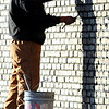 Globe/T. Rob Brown<br /> Mason Amador Villalbua with Plowman Construction Co. of Olathe, Kan., puts the finishing touches on some brickwork Monday afternoon, Jan. 9, 2012, at the Payless Shoesource on Range Line Road in Joplin.