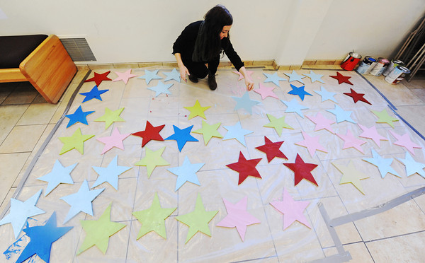 Globe/T. Rob Brown<br /> Brittany Beckett, of Neosho, an MSSU sophomore psychology major, turns over the first batch of 100 wooden stars painted by students and faculty of MSSU Monday morning, Jan. 21, 2013, as part of Stars of Hope and the Martin Luther King Jr. Day of Service. The stars are painted on both sides and each side needed the paint to dry.