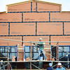 Globe/T. Rob Brown<br /> Jobie Boucher, an apprentice brick layer, sets up a layer of scaffolding for his team of brick layers Friday afternoon, Jan. 25, 2013, as construction continues on the new Subway restaurant on Seventh Street, near Maiden Lane.