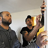 Globe/T. Rob Brown<br /> Elie Lowenfeld, left, founder of the Jewish Disaster Response Corps, works with David Gomora, a Rebuild Joplin employee from Wichita Falls, Texas, to install a new interior door trim on a Rebuild Joplin home Monday afternoon, Jan. 21, 2013, in the 1900 block of Illinois Avenue, as part of an interfaith effort involving Jews and Muslims.