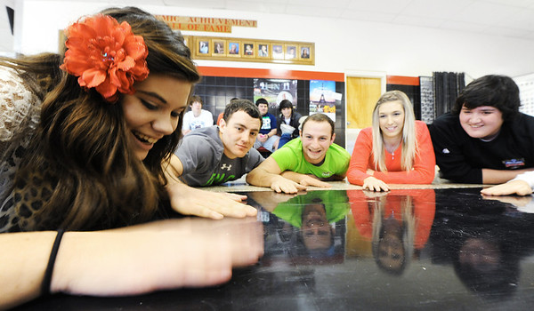 Globe/T. Rob Brown<br /> Cheyanne Chappie, left, a McDonald County High School sophomore, taps her hand on the floor during a team-building and hand-eye coordination exercise Friday morning, Jan. 4, 2013, in Tricia Hanks' leadership class. Also pictured from left are: seniors Josh Serr, Michael Long, Sha Rozell and Zack Brooks.