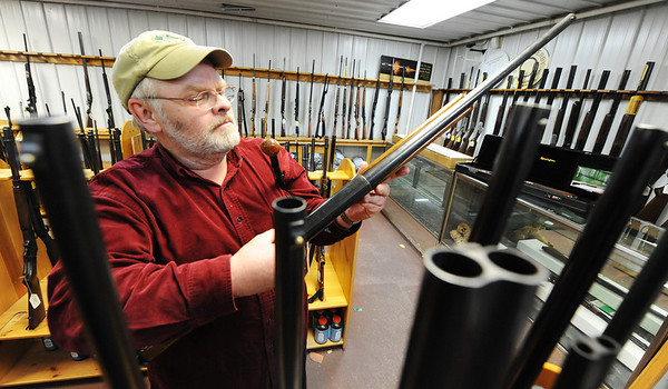 Globe/T. Rob Brown<br /> David RIggs, of Joplin, a customer at Steve's Trading Post on South Main Street, looks through the store's selection of shotguns Tuesday afternoon, Jan. 8, 2013.
