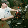 Globe/Roger Nomer<br /> Oscar Baeza works with a pipe threader at General Machinery in Pittsburg on Monday.