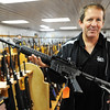 Globe/T. Rob Brown<br /> Steve, owner of Steve's Trading Post on South Main Street, holds one of his few remaining AR-15 rifles Tuesday afternoon, Jan. 8, 2013. He said demand has been up as the future of the weapon's public sales is in question.