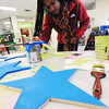 Globe/T. Rob Brown<br /> Donisha Stallings, of St. Louis, MSSU freshman physical therapy major, paints one of 100 wooden stars painted by students and faculty of MSSU Monday morning, Jan. 21, 2013, as part of Stars of Hope and the Martin Luther King Jr. Day of Service.